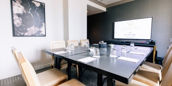 A meeting breakout room in The Gwen with a large HD TV.