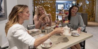 A group of friends enjoying high tea.