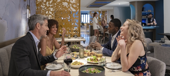 A group dine and chat at Kostali, a downtown Chicago restaurant.