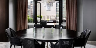 A large dining table with black chairs.