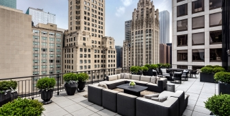 The rooftop terrace and outdoor seating of The Gwen in downtown Chicago.