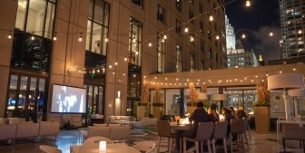 A large movie screen and outdoor movie night setup at The Gwen.