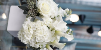 A large wedding bouquet with white and green flowers.