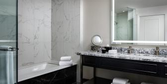 The Gwen Lux suite bathroom vanity and marble countertop.
