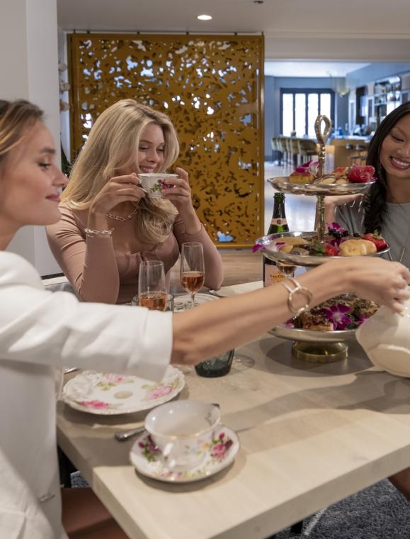 Three ladies enjoy drinks at The Gwen's tipsy tea party.