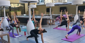 A yoga class at Upstairs at The Gwen